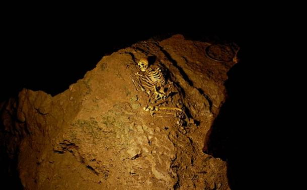 """A replica of the skeleton is exhibited in the """"Cheddar Man and the Cannibals"""" museum in Cheddar village, Somerset."""