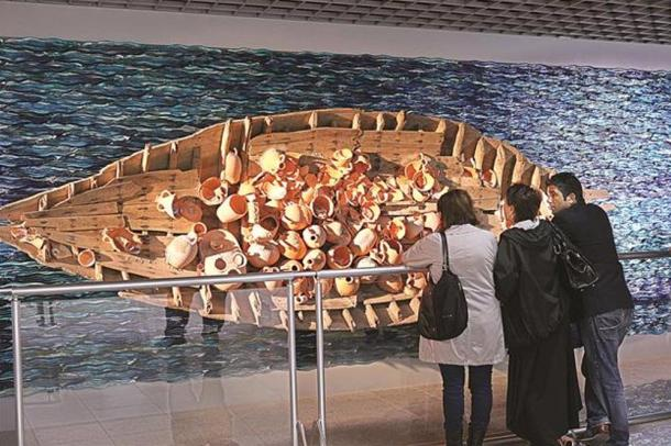 A restored ancient ship with artifacts on display in Istanbul