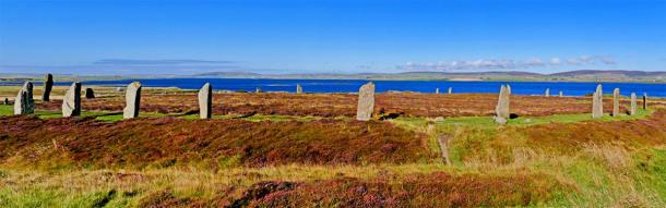 The Ring of Brodgar with Loch of Harray in the background at Mainland, Orkney Islands, Scotland. (Manel Vinuesa / Adobe stock)