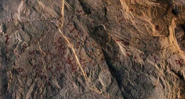 All of the rock art was a dark red color but had faded.