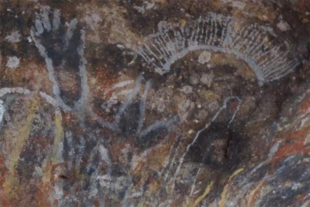 The Aboriginal rock art at Uluru that tells creation stories (pictured before the damage). (Emma Haskin / ABC)