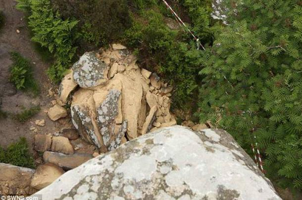 The rock sits smashed on the ground below.