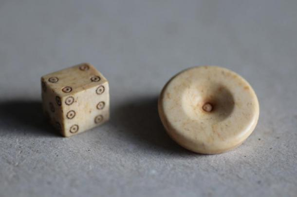 Archaeologist Professor Thomas Maurer and his team of students found some interesting artifacts, including gaming pieces