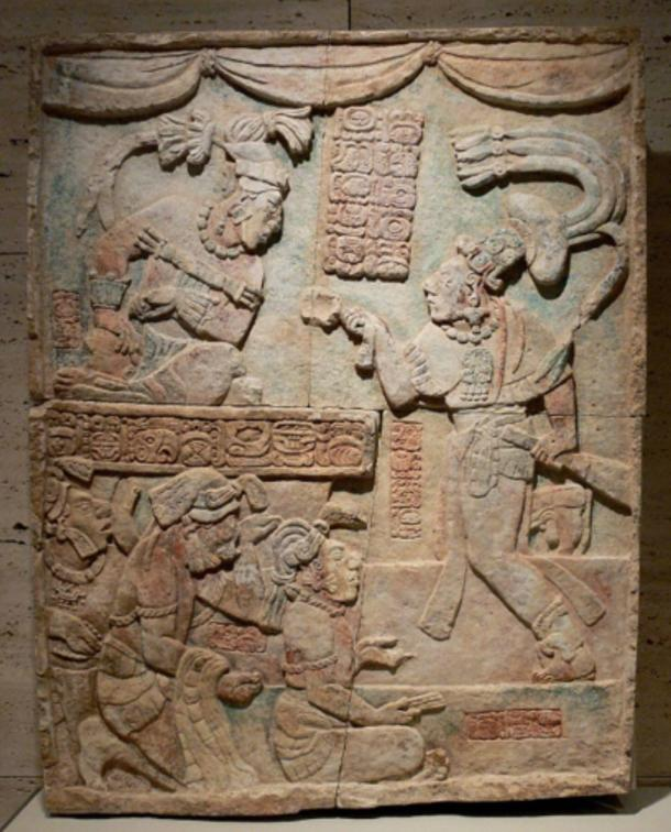 Classic period sculpture showing sajal Aj Chak Maax presenting captives before ruler Itzamnaaj B'alam III of Yaxchilan.