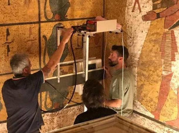 Researchers scanning the walls of King Tutankhamun's burial chamber using Ground Penetrating Radar (GPR) equipment.
