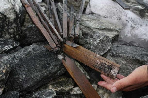 A cache of 1500 years old scare sticks found at the edge of an ice patch on Lomseggen ridge.