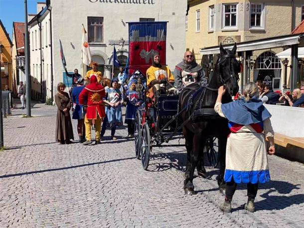 A scene on Gotland, Sweden where the knights are protecting tourists from COVID-19 (Torneamentum)