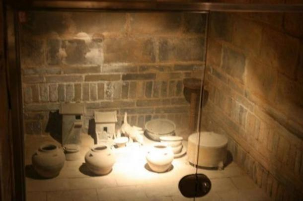 A sealed Chinese tomb with grave goods such as jars and miniature buildings, in Luoyang, Henan Province, China, built during the Eastern Han Dynasty (25–220 AD)