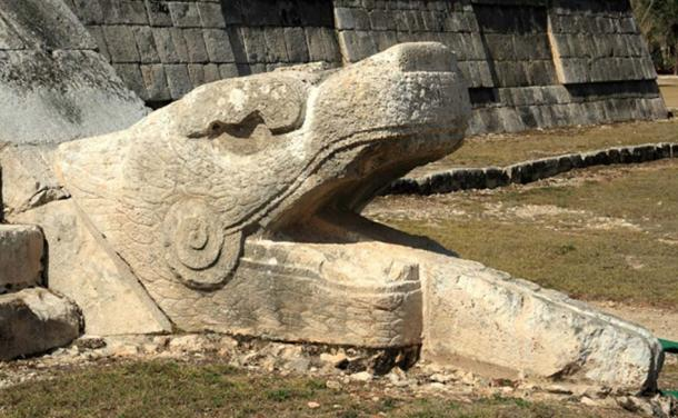 This serpent's head at El Castillo may indicate the pyramidal temple was a place sacred to Quetzalcoatl, known in Mexico and Central America as the plumed serpent and wind god and creator.