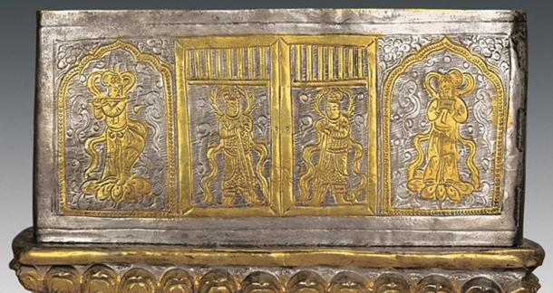 The silver coffin found inside the stupa is decorated with images of gods guarding it with swords. There are also images of spirits called asparas, who are shown playing musical instruments.