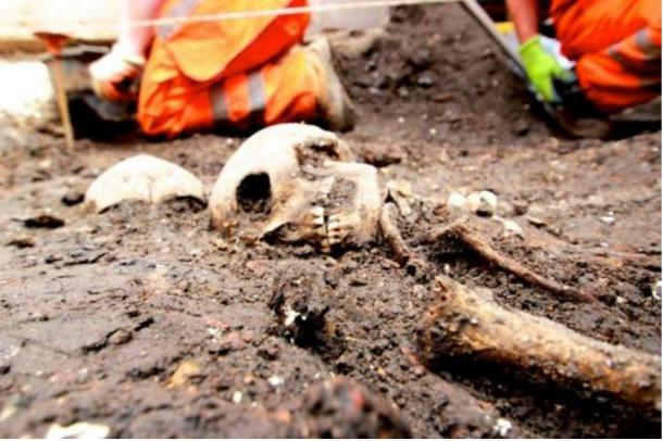 Workers uncover the skeleton of a Londoner from centuries ago in Bedlam burial ground underneath Liverpool Street.