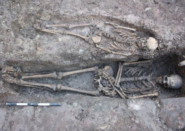 Two of the skeletons in their graves under a former car park site in Edinburgh. In another find, the knight's bones were excavated on the site of a future Edinburgh environmental center.