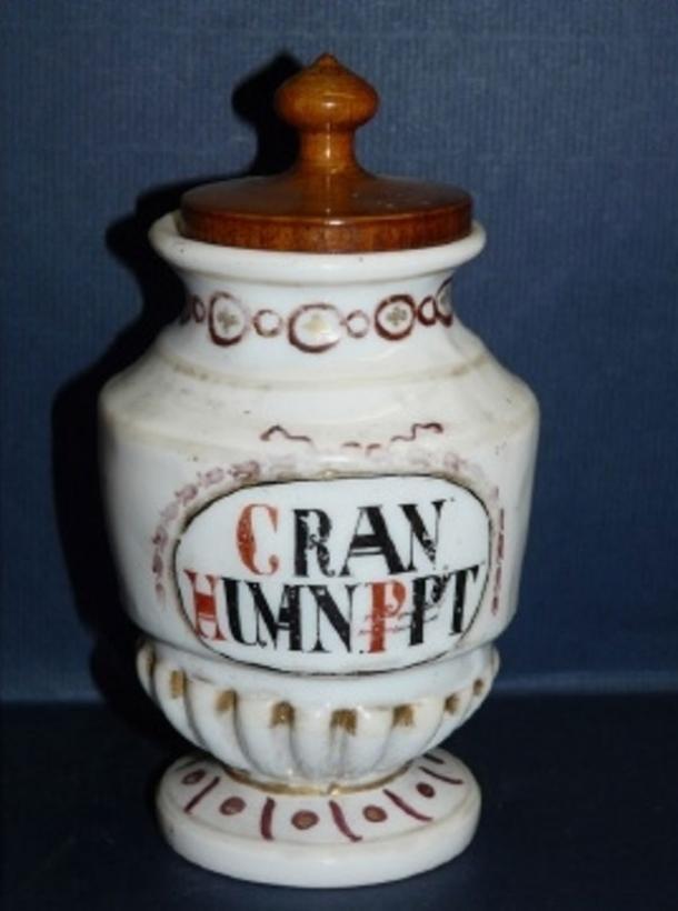 """In the 18th century skull powder was used as medicine to treat illnesses. This jar label represents """"CRAN(IUM) HUM(A)N(UM) P(RE)P(ARA)T(UM)""""."""