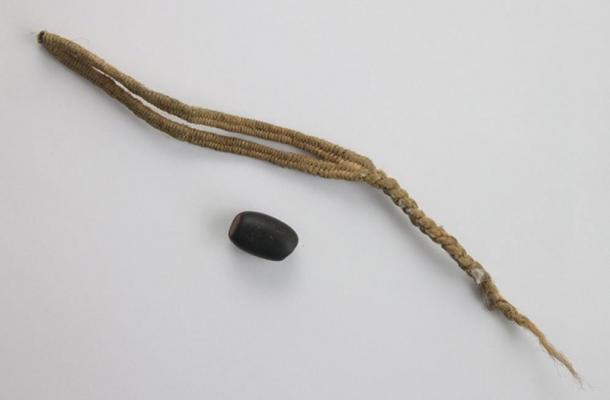 Slings were known in many other parts of the world; here is a sling with a black bullet from Peru, the Inca period.