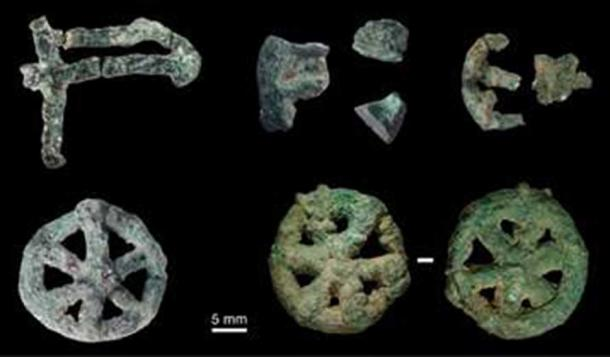 A collection of small lost-wax cast ornamental objects found during excavations at the MR2 site at Mehrgarh.