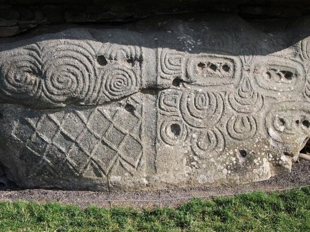 The triple spiral carvings on a wall at Newgrange