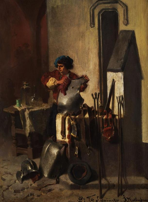 A squire cleaning armor, training for knighthood