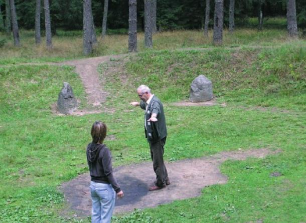 "People standing inside stone circles and ""tuning into the energy"" in Grzybnica."