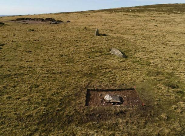 The arc of former standing stones at Waun Mawn during trial excavations in 2017, viewed from the east. Only one of them (third from the camera) is still standing. Recumbent stone 13 is in the foreground (photograph by A. Stanford/ Antiquity Publications Ltd)