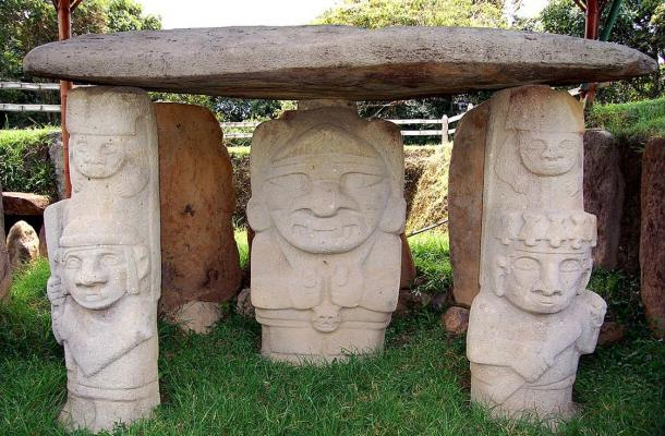 Some of the stone statues in the San Agustín Archaeological Park. This is described as a tomb with a deity. Warriors with alter egos serve as pillars for the tomb.