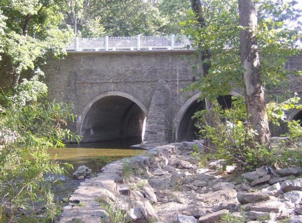 The stone arch bridge on Frankford Avenue in Holmesburg, Philadelphia, Pennsylvania. Erected in 1697 in the Holmesburg section of Northeast Philadelphia, in the U.S. state of Pennsylvania, it is the oldest surviving roadway bridge in the United States.