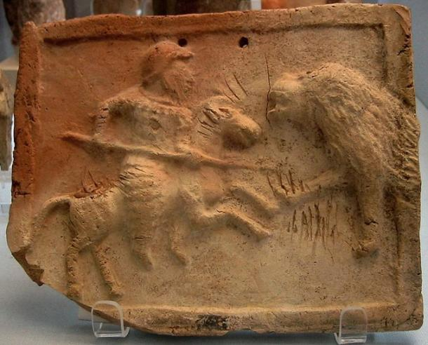 A stone-etched relief depicting a Parthian cataphract fighting against a lion. Housed in the British Museum.