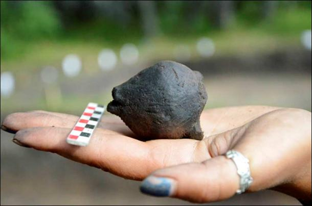 There are little stones inside. We don't know what kind of stones these are, but we will be doing an X-ray to find out. The rattle is still working.' Picture: Lyudmila Mylnikova / Institute of Archaeology and Etnography SB RAS.