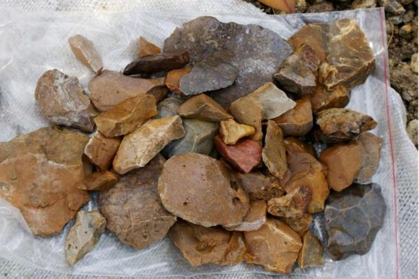 These stone tools, discovered near the site where the very ancient tools were found, could not be dated because they were on the surface of the earth.