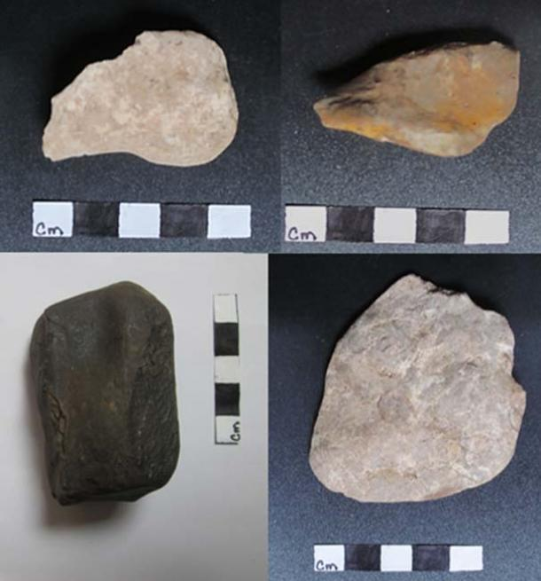 Three possible stone tools and one of the soft black rocks found in one of the caves.