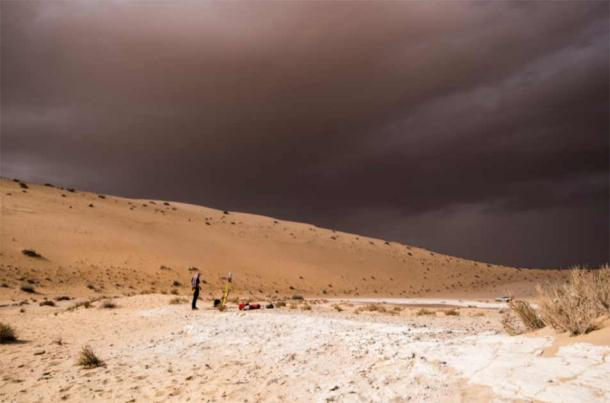 A storm arrives during archaeological excavation of the remains of ancient lake in northern Saudi Arabia, where ancient humans lived alongside animals such as hippos. (Klint Janulis, Palaeodeserts Project)