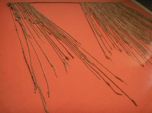 A string of khipu in a museum in Lima.