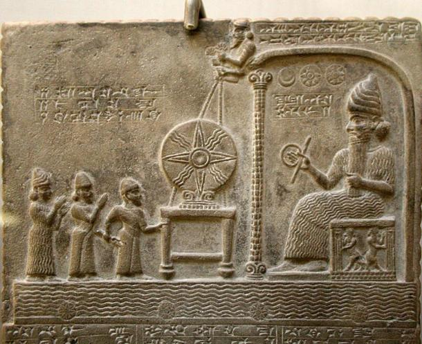 The Babylonian sun god Shamash sits on his throne while meeting with a king and two deities.