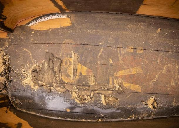 The ancient Egyptian sun god Ra-Horakhty is barely visible inside the coffin of Ankh-Khonsu. (Kris Snibbe / Harvard Gazette)