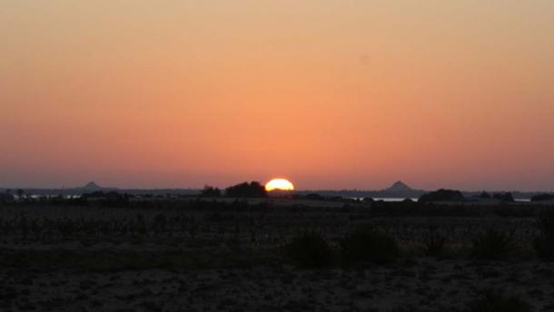 The sun rises right behind the Aghurmi mound on the spring equinox.