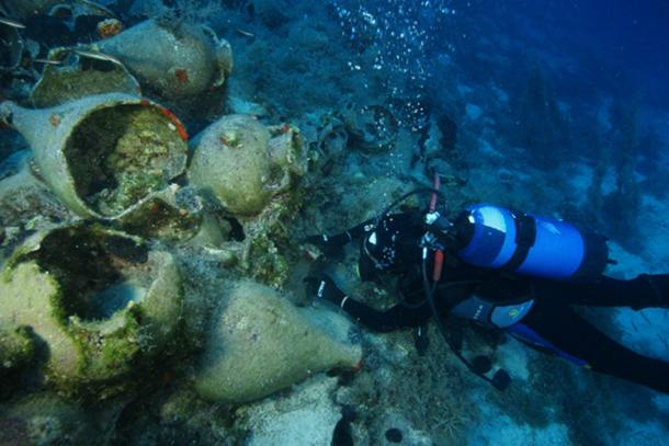 A diver explores a sunken cargo of amphorae from the late Archaic period (c. 525-480 BC).