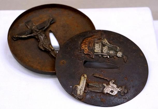 A sword guard identified as belonging to a hidden Christian has a statue of Jesus Christ inside it, while a foreign vessel is engraved on its outer side.