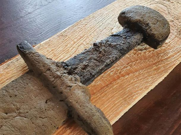 The hilt of the rare medieval sword found in the lake with its intact leather scabbard. (Nicolaus Copernicus University)