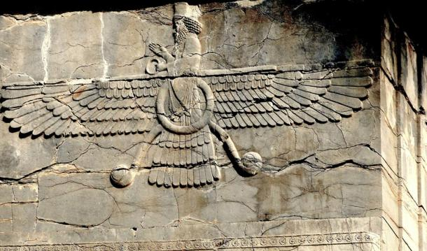 The symbol of Zoroastrianism named Faravahar seen at the ruins of Persepolis, Iran