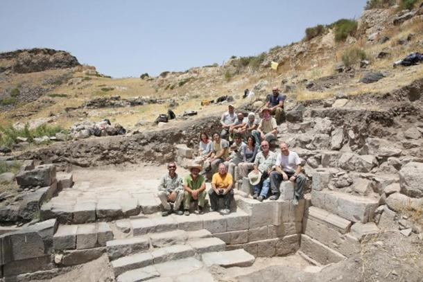 The team and the gate they have excavated.