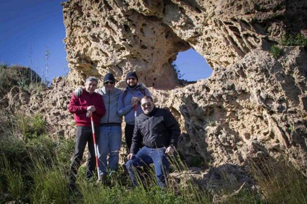 The team of researchers by the newly discovered calendar rock in Sicily.