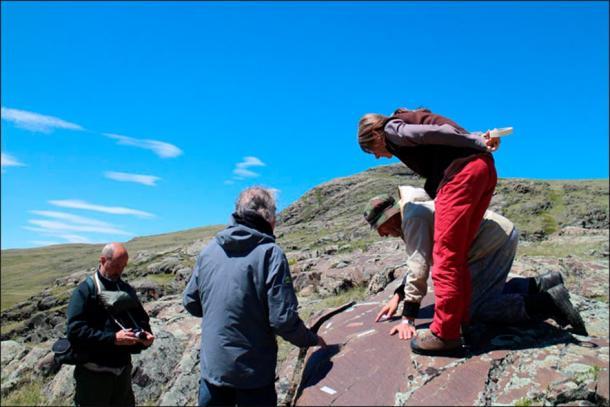 The team of archaeologists inspecting the Paleolithic rock art at Kalgutinsky Rudnik, Russia. (Hugues Plisson & Lidia Zotkina / Siberian Times)