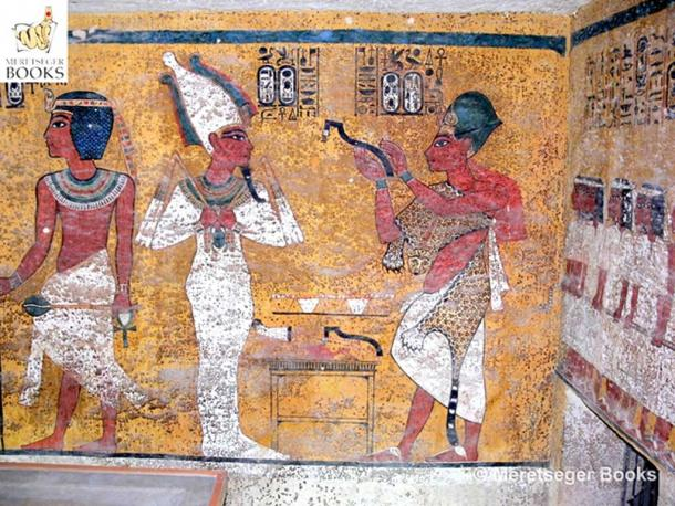 """This scene on the north wall in KV62 shows King Aye, who wears the Blue Crown and the leopard-skin robe of sem priest, perform the """"Opening of the Mouth"""" ritual on the mummy of Tutankhamun. 18th Dynasty. (Photo: Meretseger Books)"""