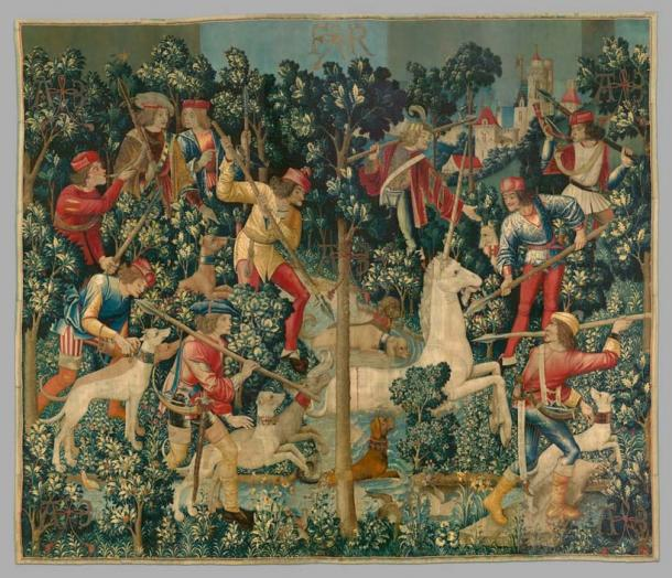 The third tapestry of the Unicorn Tapestries - The Unicorn is Attacked or The Unicorn Leaps into the Stream. (The Public Domain Review / Public Domain)