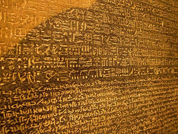 Detail of two of the three languages on the Rosetta Stone