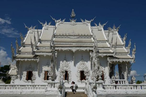 Classical, three-tiered roof of the all-white ubosot