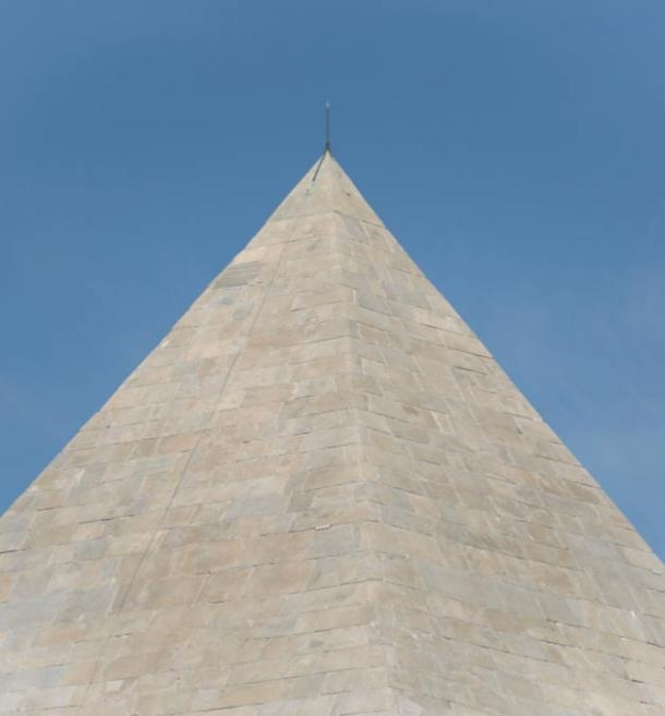The tip of the Pyramid of Cestius, now back to its shiny white surface