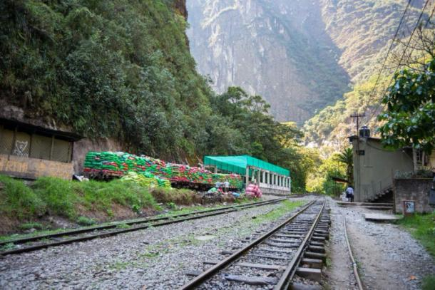 Machu Picchu trash crisis - Garbage train ready to travel out of Machu Picchu, Peru. (fabio lamanna / Adobe stock)