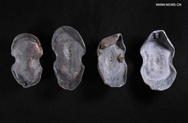 The treasure found in in Sichuan, China also includes these silver ingots with writing still visible on them.