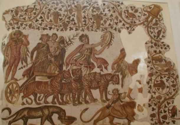 The triumph of Dionysus, with a maenad playing a tympanum, on a Roman mosaic from Tunisia (3rd century AD).