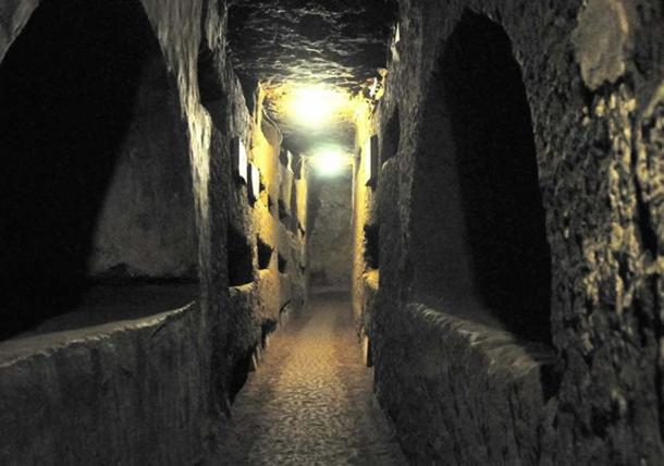 A tunnel showing some of the crypts built into the walls of the Catacombs of St. Domitilla